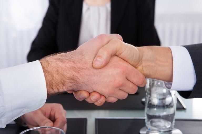 bigstock-Businesspeople-Shaking-Hand-63371740 (Custom).jpg